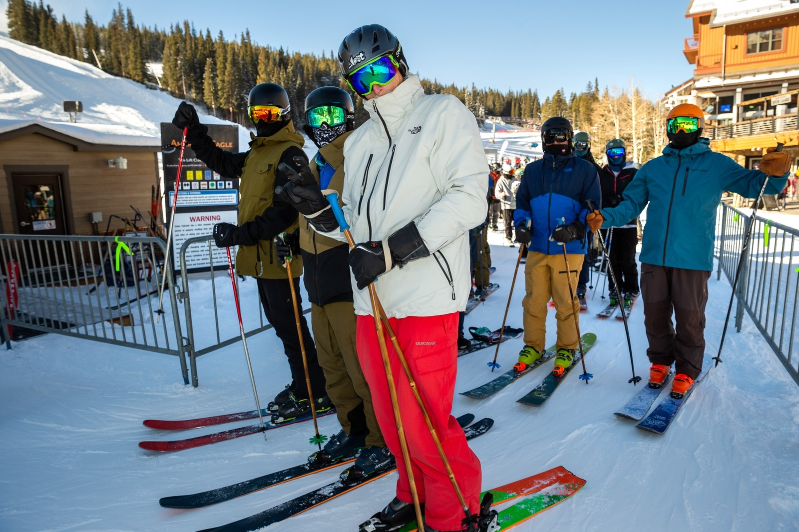 Skiers stand in line on opening day Monday, Nov. 30, at Copper Mountain Resort in Frisco.