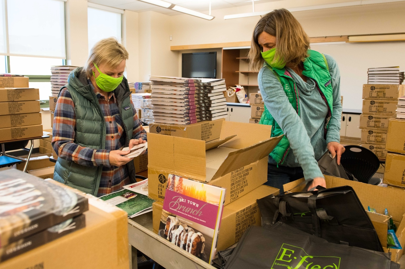 Wendy Rimel, left, and Heidi Trueblood pack gift bags for Eagle County Schools employees Thursday morning. The Education Foundation of Eagle County is delivering a gift bag to every school district employee, to show appreciation and give thanks for their hard work to keep students learning and students and teachers safe during the coronavirus pandemic.