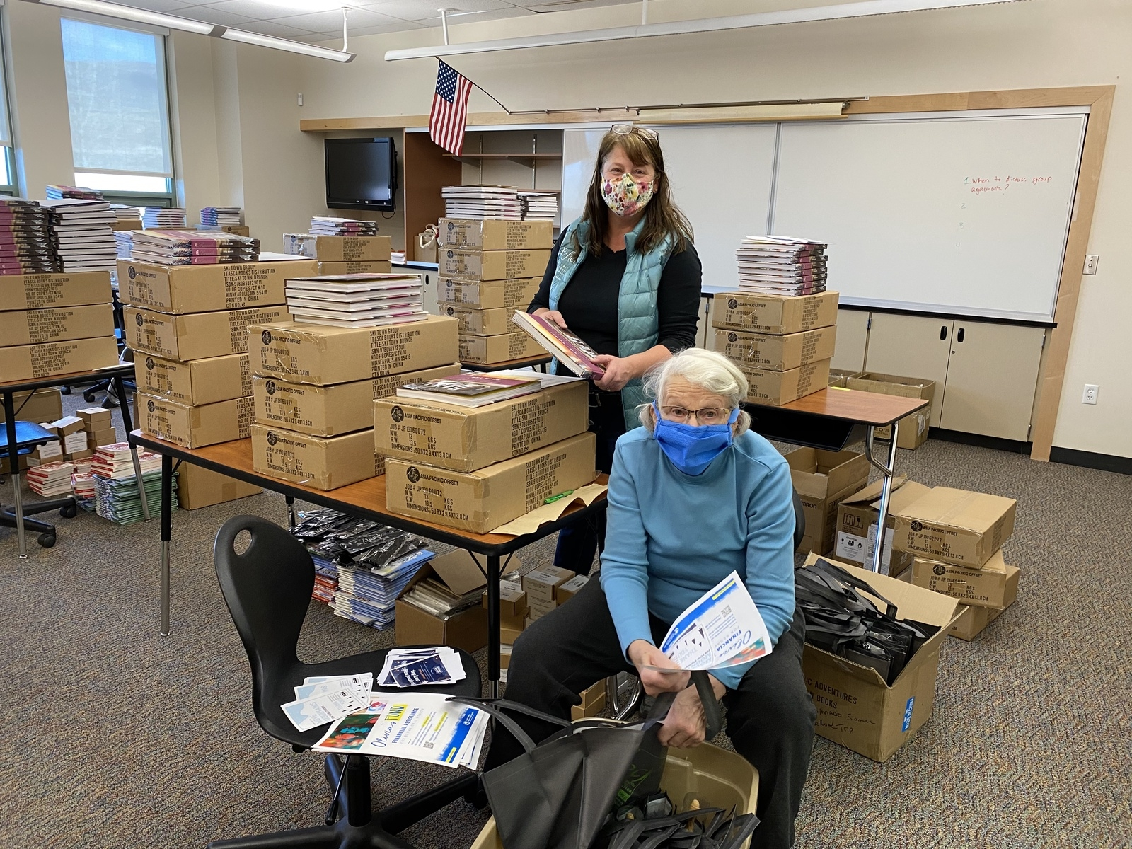 Julie Overy, back, and Angela Overy help pack gift bags for Eagle County Schools employees. The Education Foundation of Eagle County is delivering gift bags to every school employee to say thank you.