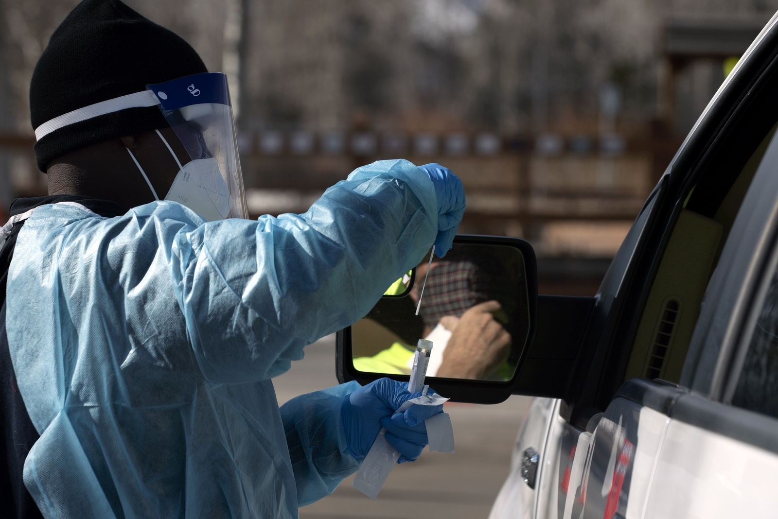 A MAKO Medical technician handles a COVID test at the Silverthorne drive-through testing site on Friday, Nov. 20. Approximately 200 - 300 tests are being processed each day at the site.