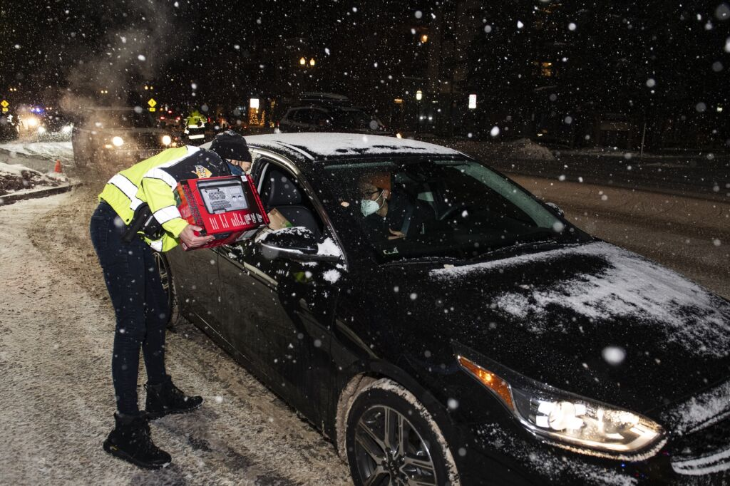 Community response officer Rachel Beck spoke with the person who provided him with space heaters outside the Aspen police station on Monday, December 28, 2020.  (Kelsey Brunner / The Aspen Times)