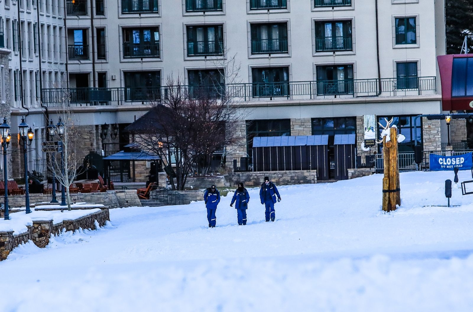 Lift Operators walk down the beach after a shift before opening day Tuesday in Beaver Creek. The resort is scheduled to open Wednesday, Nov. 25.