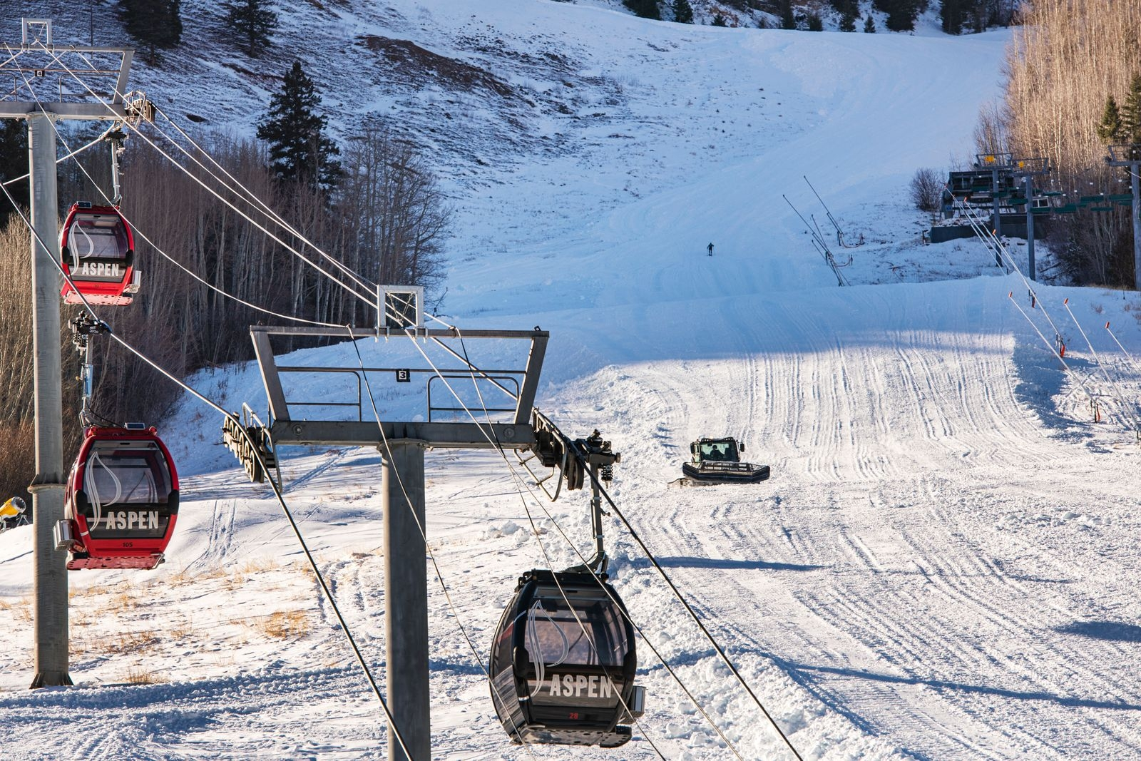 Aspen Skiing Company grooms the Little Nell run on Aspen Mountain in preparation for a Thanksgiving opening day on Tuesday, Nov. 17, 2020. (Kelsey Brunner/The Aspen Times)