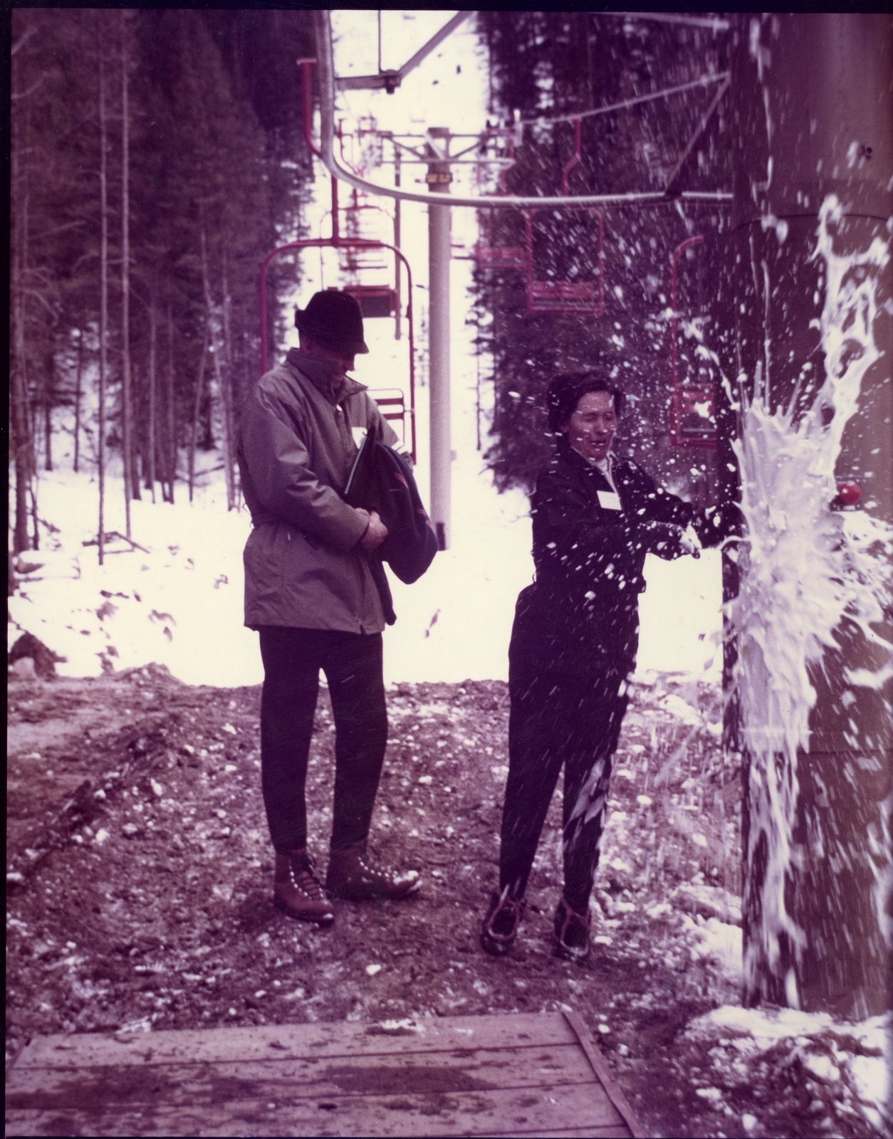 Breaking a champagne bottle off a lift tower signifies the grand opening of Keystone Mountain Ski Area on Nov. 21, 1970. | Photo from the Bergman family