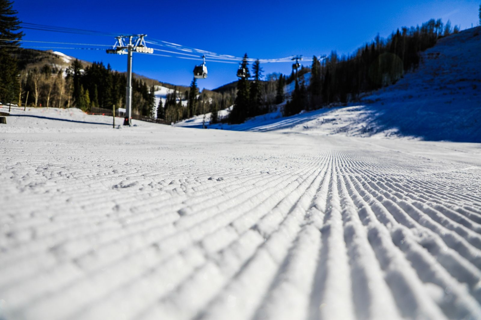 Freshly groomed corduroy lines the base of Gondola One Tuesday in Vail. The resort is still scheduled to open Friday.