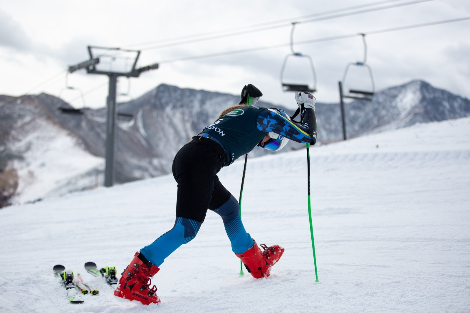 With the Tenmile-Mosquito Range in view in the distance, a U.S. skier stretches out during training at Copper Mountain Resort earlier this month.   Photo from U.S. Ski & Snowboard