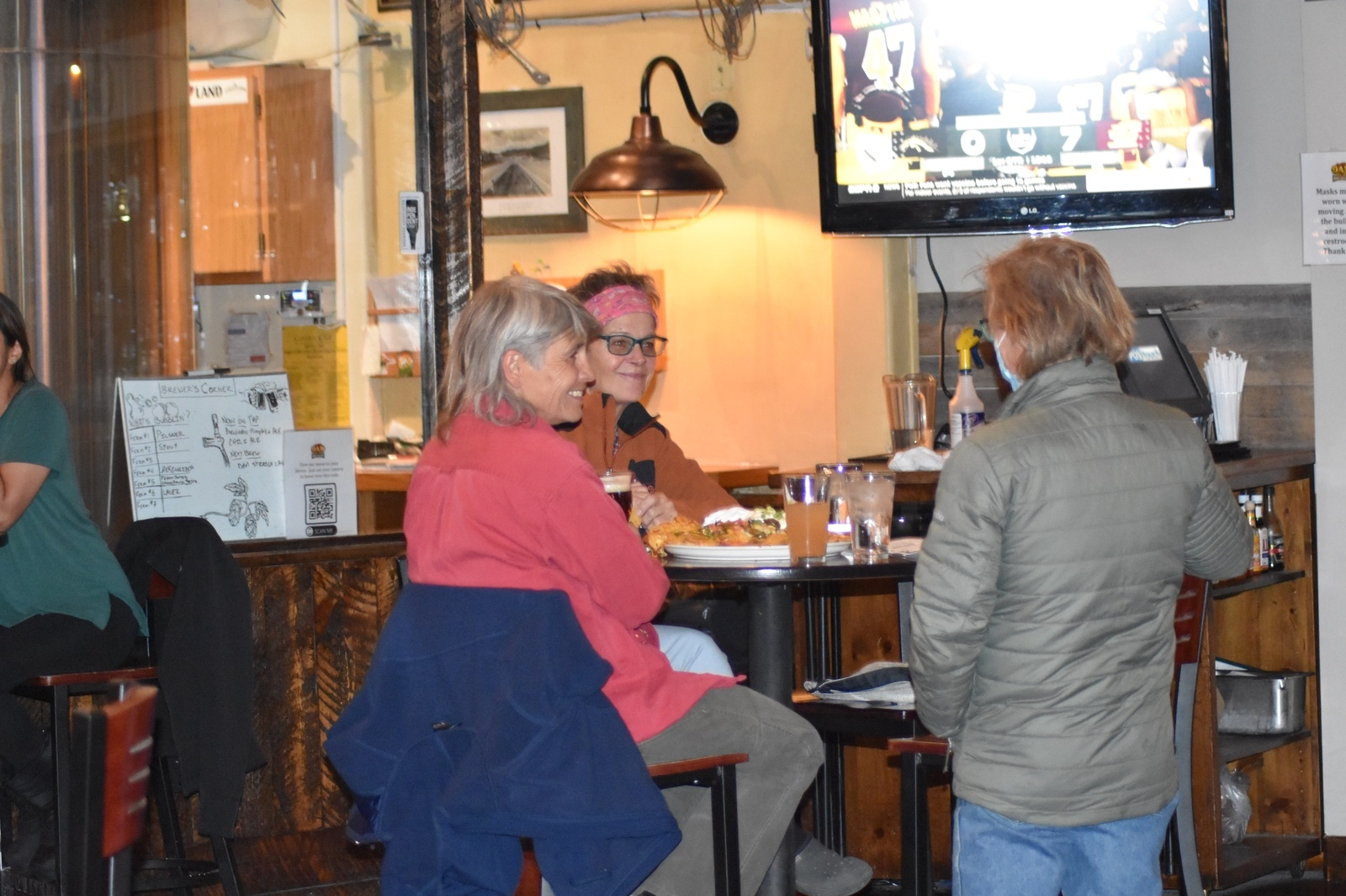 Diners eat at Dillon Dam Brewery on Wednesday, Nov. 18. Restaurants in Summit County will be subject to new restrictions beginning at 5 p.m. Sunday, Nov. 22, including an 8 p.m. last call and no indoor dining. | Photo by Taylor Sienkiewicz / tsienkiewicz@summitdaily.com