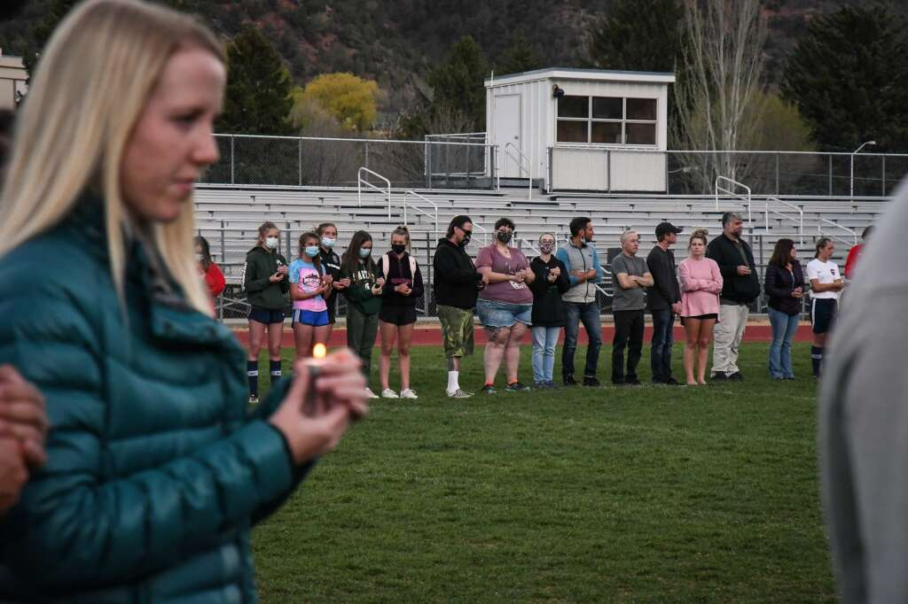 Students, teachers, and friends of the late Jim Benson gather for a candle light vigil on Thursday evening at Glenwood Springs High School.  Chelsea Self / Post Independent