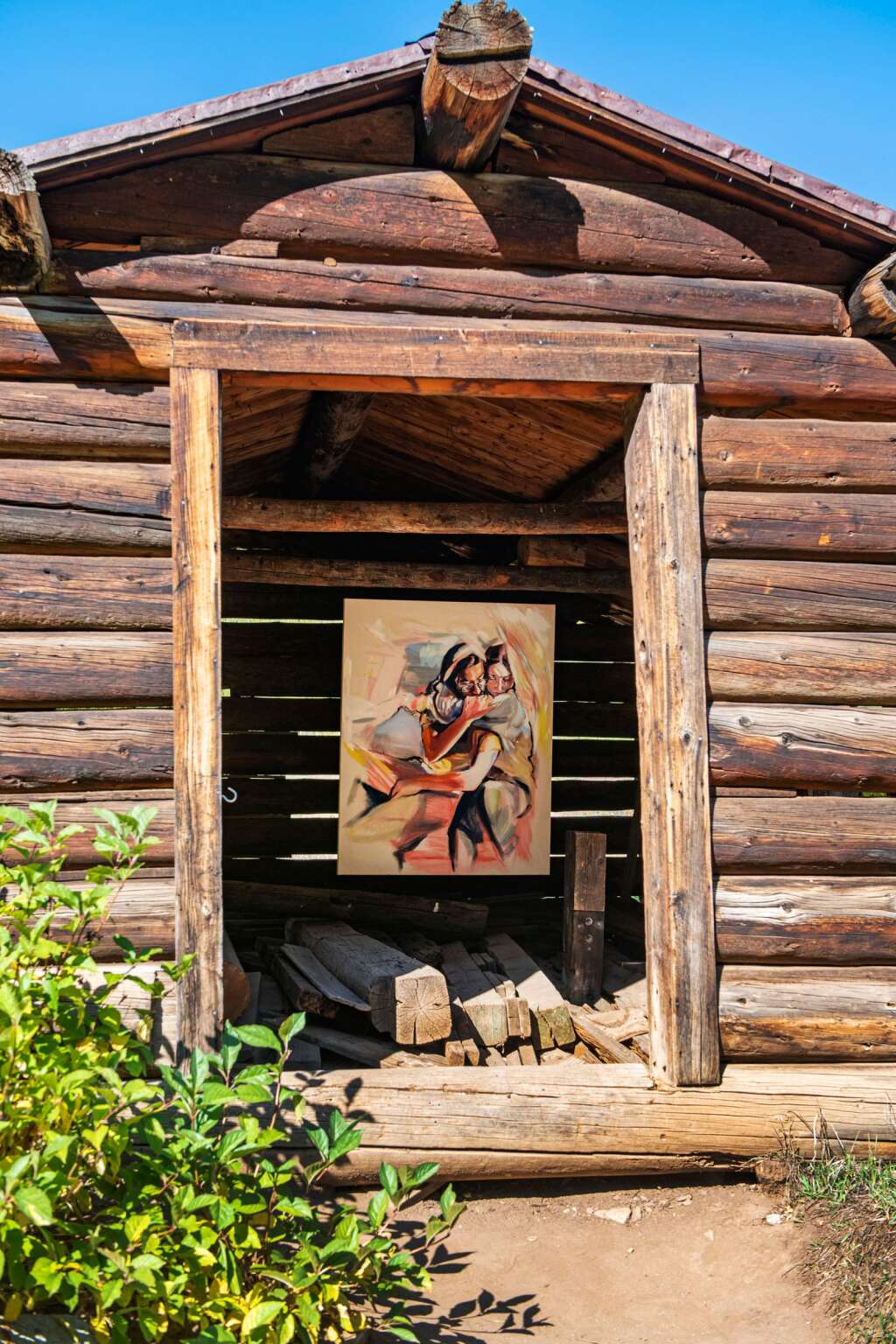 A painting of two dear friends of artist Kaitlyn Tucek is displayed in a building at the entrance to the Ashcroft Ghost Town as part of her temporary two-day exhibition 'The Lilac Hour' outside of Aspen on Friday, Sept. 17, 2021. (Kelsey Brunner/The Aspen Times)