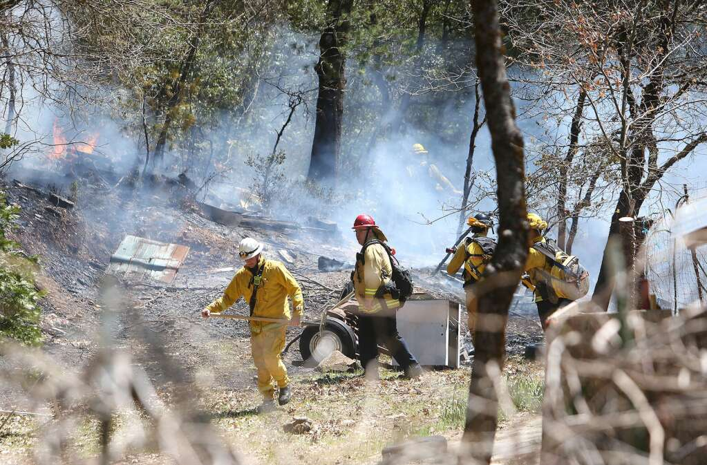 Cal Fire and City of Grass Valley firefighters work to contain an escaped burn pile off of the 12,000 block of Gold Starr Lane in rural Grass Valley mid April. The fire was quickly knocked down and kept to less than 1/4 of an acre. | Photo: Elias Funez