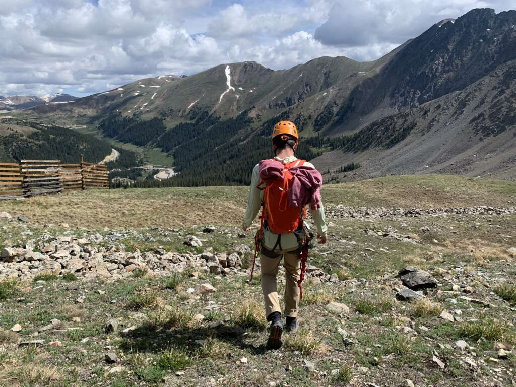 Arapahoe Basin Ski Area via ferrata guide Dawson Viles leads guests on the hike from the top of the Lenawee lift over to the base of the via ferrata climb on the East Wall on Tuesday, June 29.   Photo by Antonio Olivero / aolivero@summitdaily.com