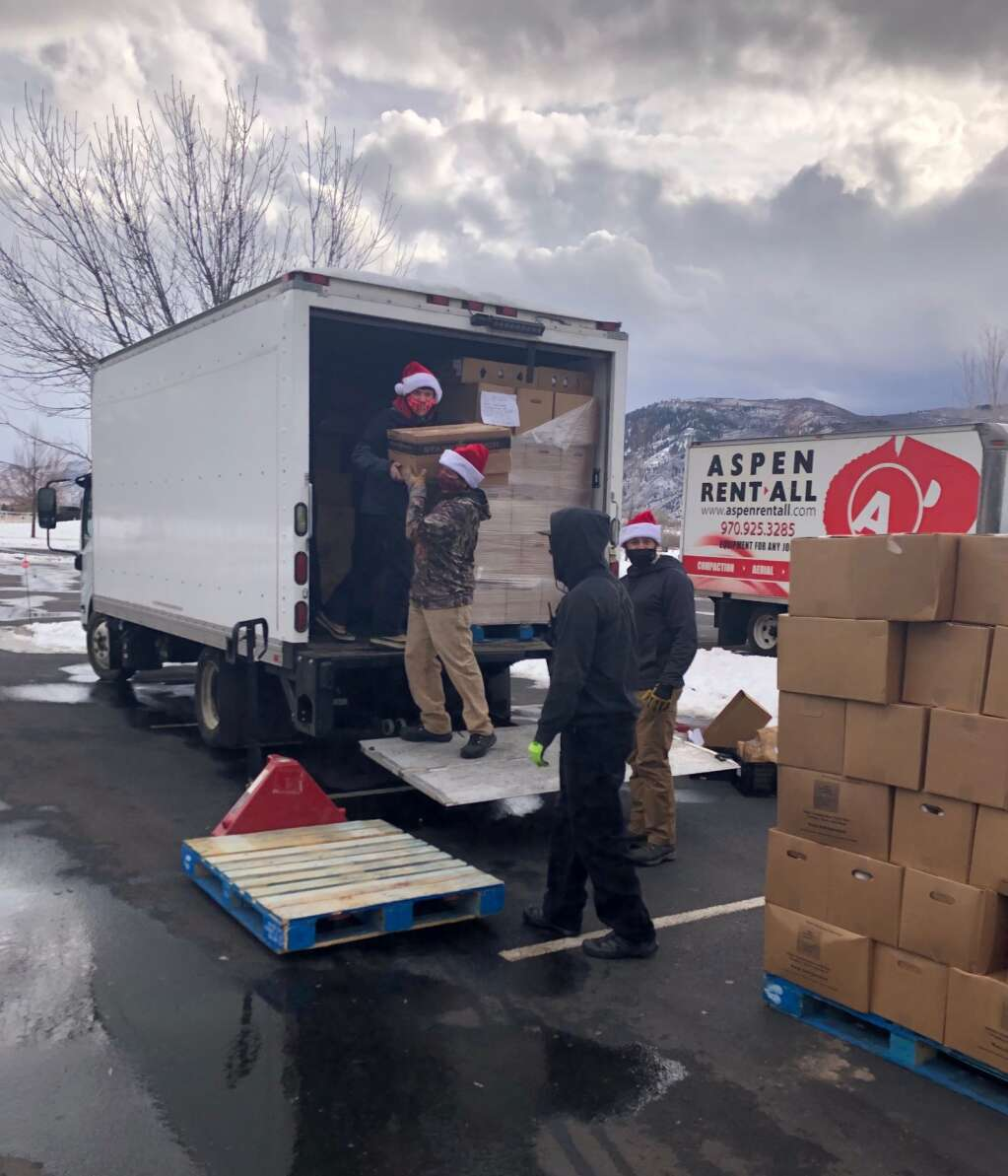 Aspen Skiing Co. workers load up the leftovers on Tuesday for other food distribution efforts this week. | Scott Condon/The Aspen Times