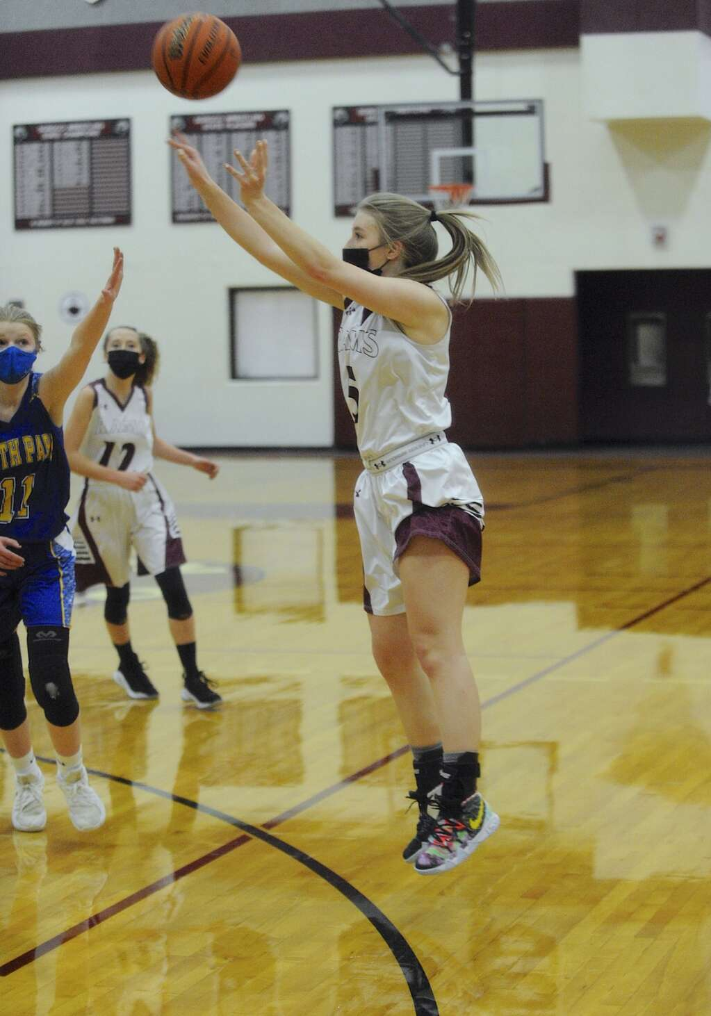 Soroco junior Peyton Parker pulls up for a 3-point shot during a game in Oak Creek on Saturday afternoon. (Photo by Shelby Reardon)