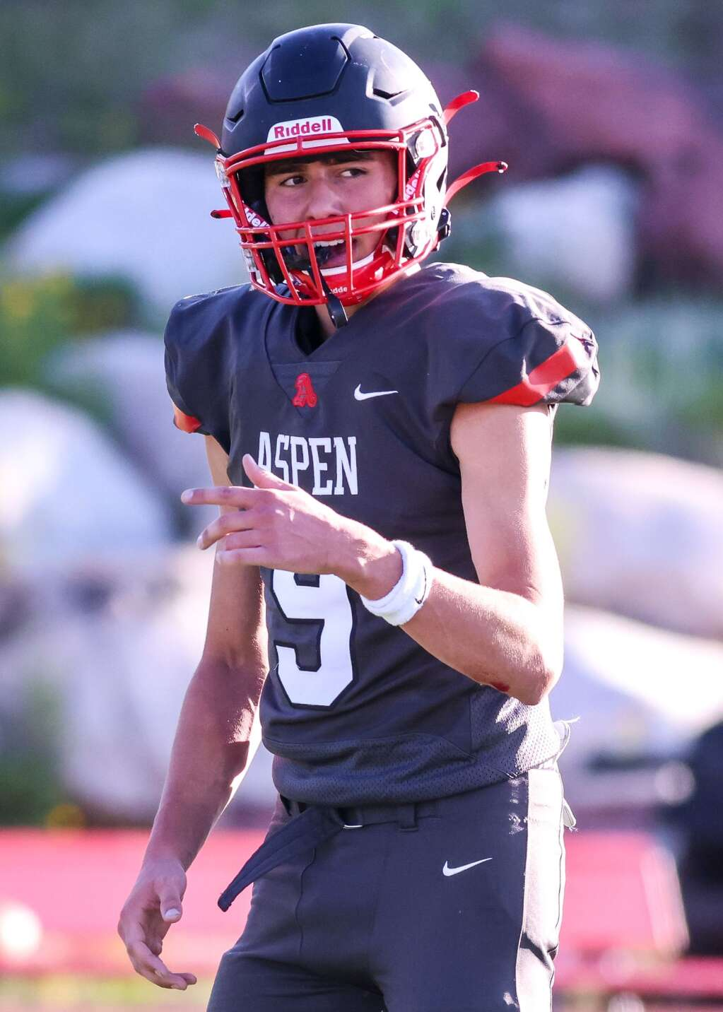 Aspen High School quarterback Porter Lee prepares to take the snap as the football team hosts Colorado Springs Christian on Friday, Aug. 27, 2021, on the AHS turf. | Photo by Austin Colbert/The Aspen Times