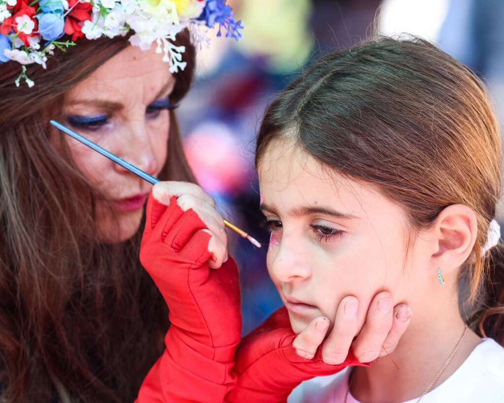 A girl gets her face painted during the Fourth of July celebration in Aspen on Sunday, July 4, 2021, in downtown Aspen. Photo by Austin Colbert/The Aspen Times.