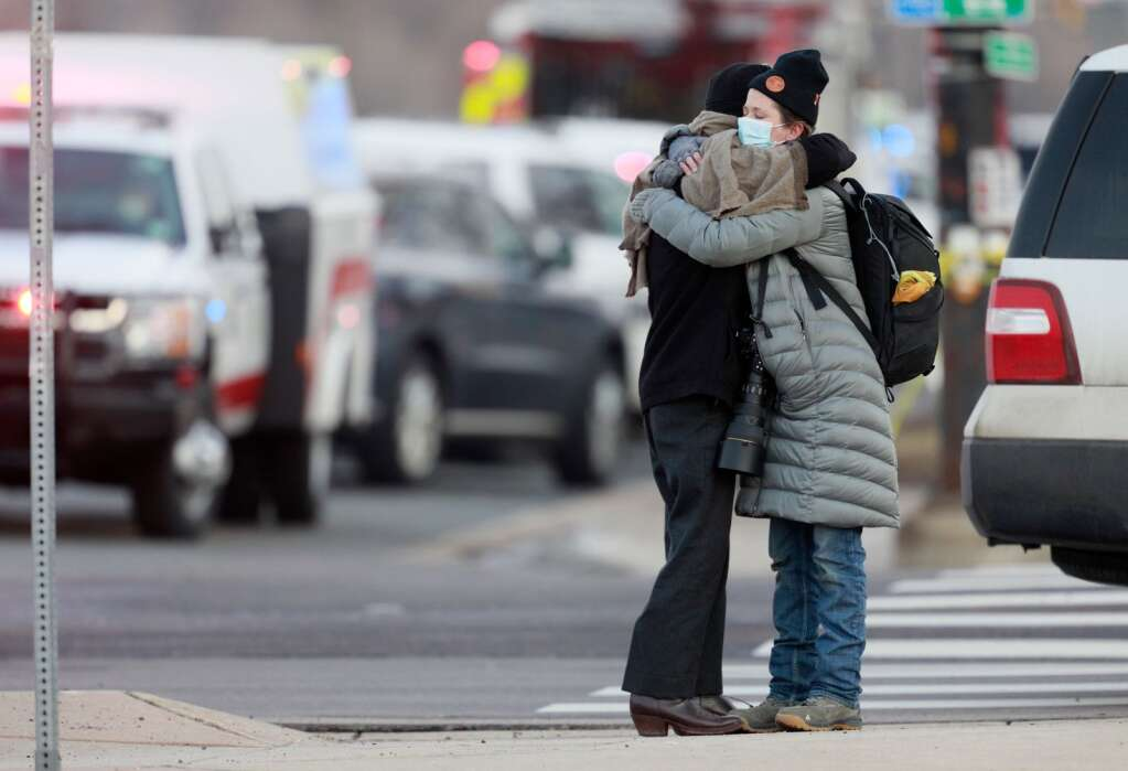 Women hug on the corner of Broadway and Table Mesa Drive near a King Soopers grocery store where a shooting took place Monday, March 22, 2021, in Boulder, Colo.  (AP Photo/Joe Mahoney)