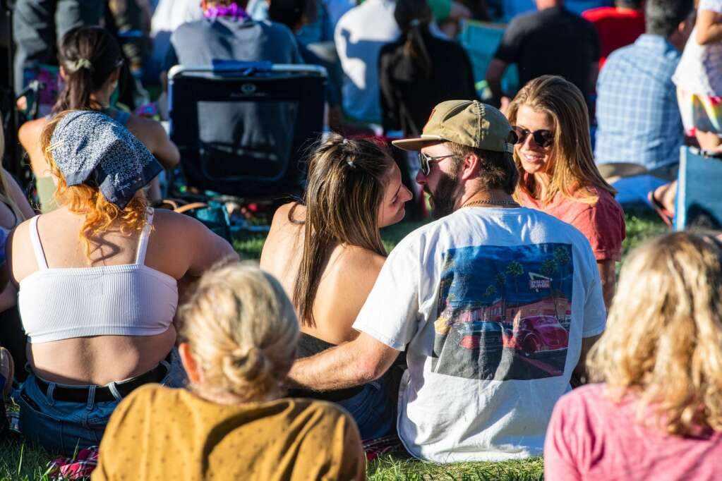 A couple shares a moment on Fanny Hill during the first free concert of the summer since the pandemic shut down live music in Snowmass Village on Thursday, June 10, 2021. (Kelsey Brunner/The Aspen Times)
