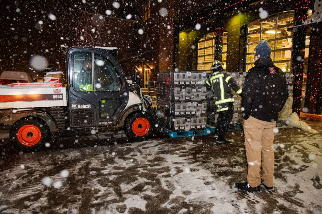 Space heaters are unloaded outside of the Aspen Volunteer Fire Department for Aspen residents without heat during a gas outage in town on Monday, Dec. 28, 2020. (Kelsey Brunner/The Aspen Times)