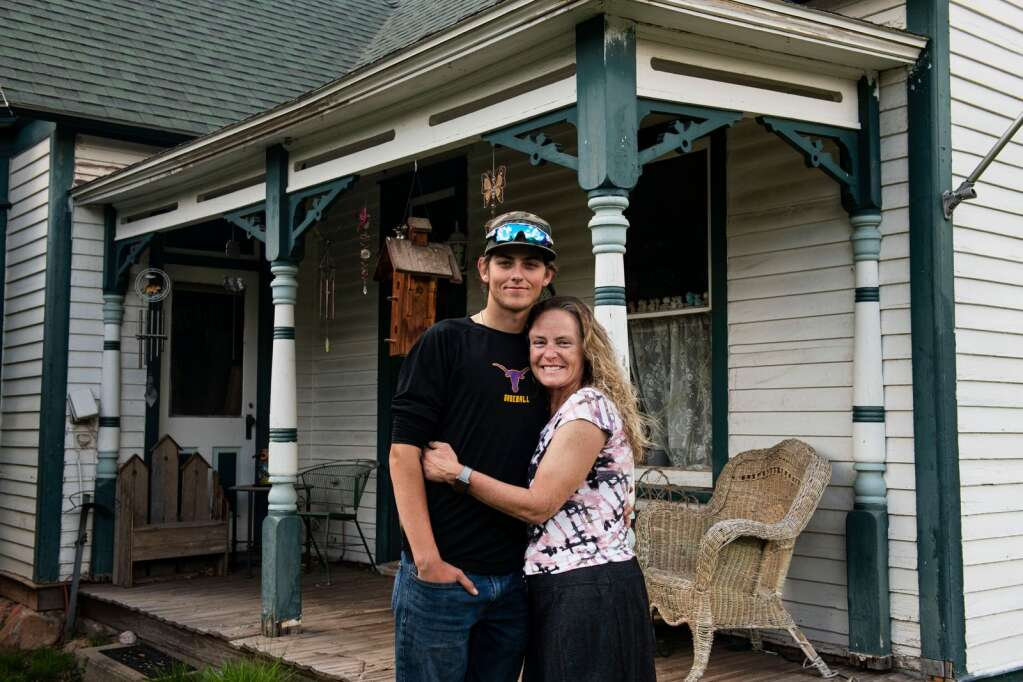 Basalt High School graduating senior Tyler Sims and his mother Carrey Sims stand outside of the home they both grew up in at their family's original homestead in Basalt on Wednesday, May 19, 2021. Tyler is the 6th generation of his family with ties to Basalt. (Kelsey Brunner/The Aspen Times)