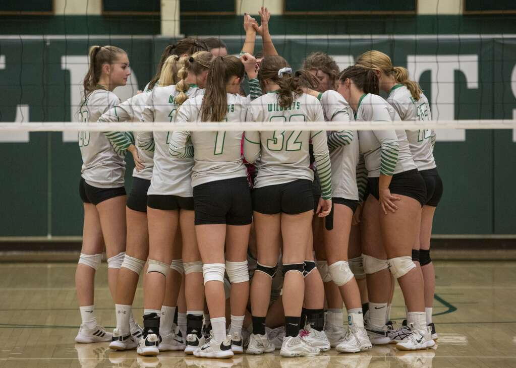 The South Summit High School volleyball team huddles on the court prior to their matchup against Layton Christian Academy Thursday evening, Sept. 16, 2021. The Wildcats fell to the Eagles 3-2. (Tanzi Propst/Park Record)