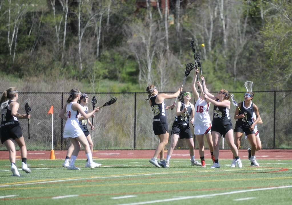 Steamboat Springs junior lacrosse player Erin Maitre reaches for the ball during a home game against Battle Mountain on Wednesday evening. (Shelby Reardon)