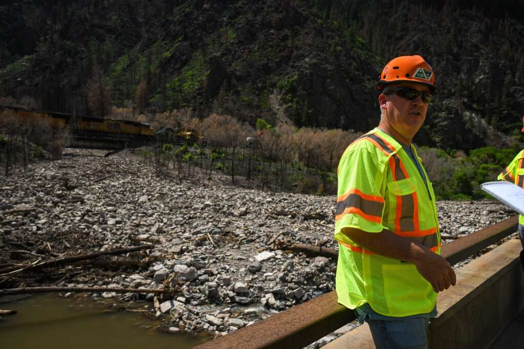 CDOT Region Transportation Director Mike Goolsby talks about the debris slide that came down from the Devil's Hole drainage and partially dammed a portion of the Colorado River Thursday, July 22 in Glenwood Canyon near MM124. |Chelsea Self / Post Independent