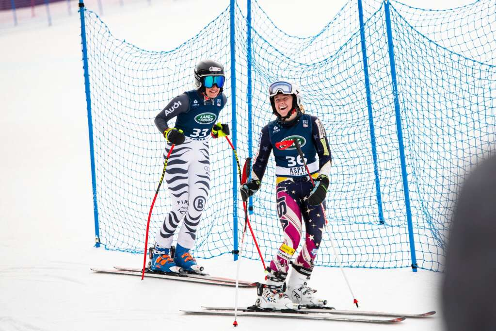 American alpine skiers Resi Stiegler, left, and Paige Doyle chat at the bottom of Aspen Highlands after their second run for the Women's FIS Super G event on Tuesday, April 13, 2021. (Kelsey Brunner/The Aspen Times)