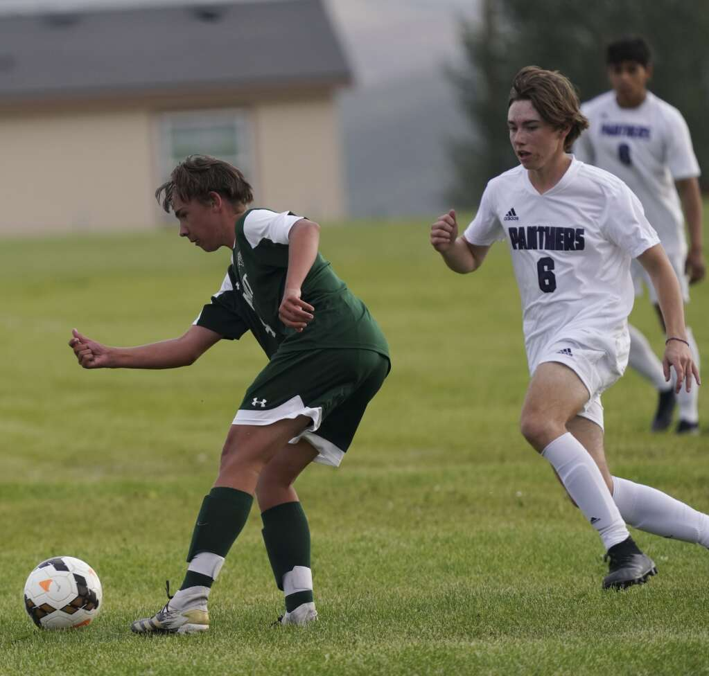 Evan Reil (left) collects a pass during the Summit High School varsity boys soccer team's scrimmage vs. Middle Park High School on Tuesday at Middle Park. | Photo by Eli Pace / Sky-Hi News