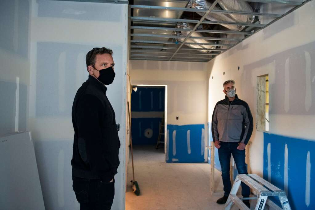 The Arts Campus at Willits' Ryan Honey, left, and Kendall Smith stand in what will be the new performing arts center's green room above the stage in Basalt on Thursday, March 18, 2021. (Kelsey Brunner/The Aspen Times)
