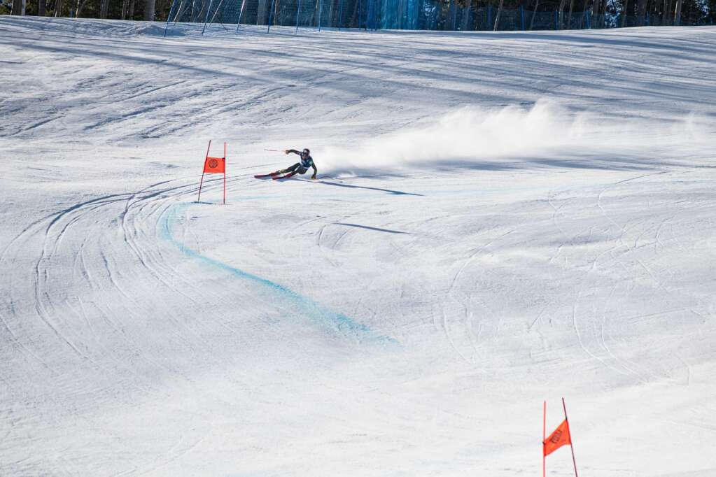 American alpine skier Thomas Biesemeyer makes turns during the first run of the Men's Downhill National Championship at Aspen Highlands on Saturday, April 10, 2021. Biesemeyer tied for first place. (Kelsey Brunner/The Aspen Times)