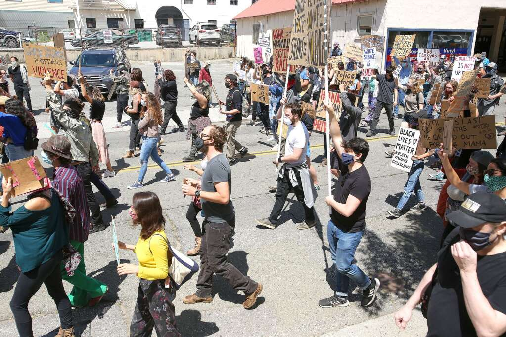 Peaceful protesters begin marching along South Auburn Street June 6 in downtown Grass Valley as nationwide police reform protests continue to happen. | Photo: Elias Funez