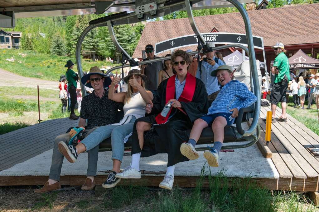 Aspen High School graduates and their family load onto the Tiehack lift after the commencement ceremony at the school on Saturday, June 5, 2021. (Kelsey Brunner/The Aspen Times)