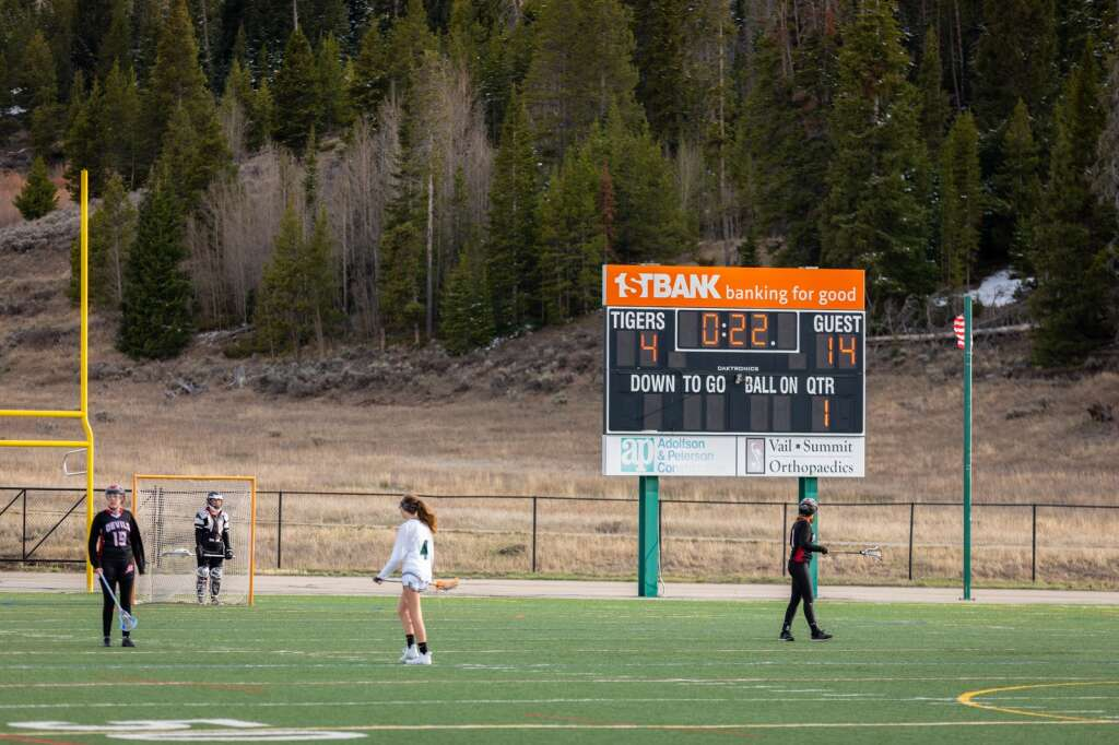 The scene at the end of the game of the Summit High School varsity girls lacrosse team's 14-4 loss to Eagle Valley at Summit High School in Breckenridge on Tuesday, May 11, 2021. | Photo by Lucas Herbert / Lucas Herbert Media