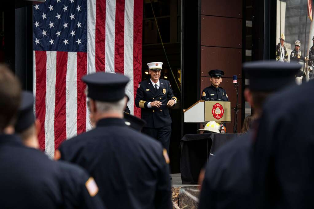 Aspen Fire Department Chief Rick Balentine stands on stage for the 20th Annual 9/11 Memorial Day at the Aspen Volunteer Fire Department in East Hopkins on Saturday, September 11, 2021.  (Kelsey Brunner / The Aspen Times)