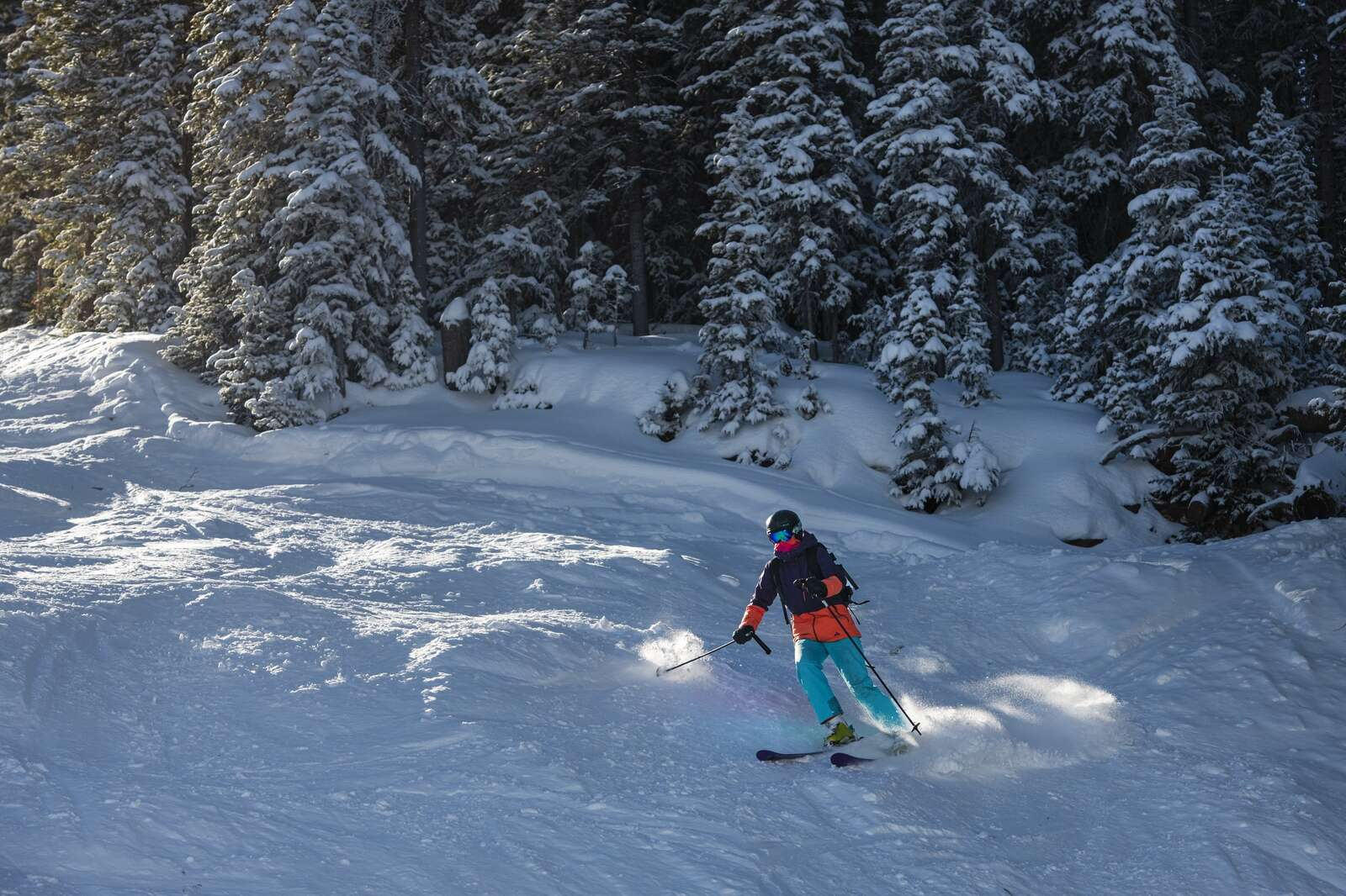 A skier maneuvers through the moguls on Pussyfoot on opening day on Aspen Mountain on Wednesday, Nov. 25, 2020. (Kelsey Brunner/The Aspen Times)