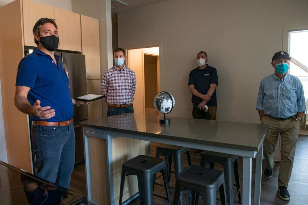 Skico's Philip Jeffreys (left) leads a tour of the Hub at Willits, a 43-unit affordable housing project on Thursday, Sept. 9, 2021. (Kelsey Brunner/The Aspen Times)