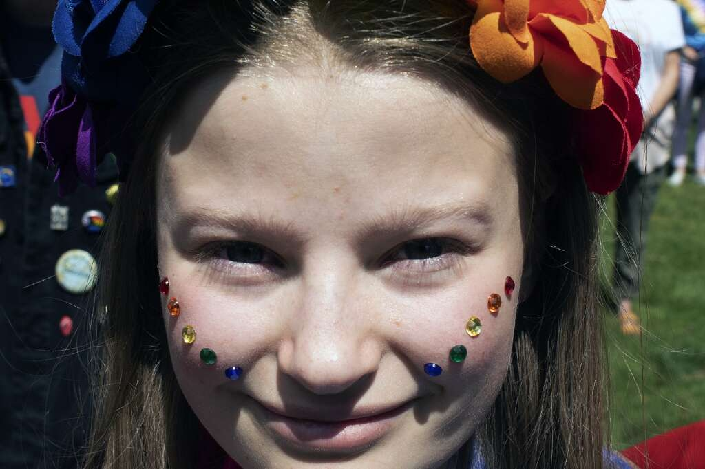 Cameron Scott of Frisco wears Pride-colored sequins on her face during the Pride March in Frisco on Sunday, June 27. | Photo by Jason Connolly/ Jason Connolly Photography