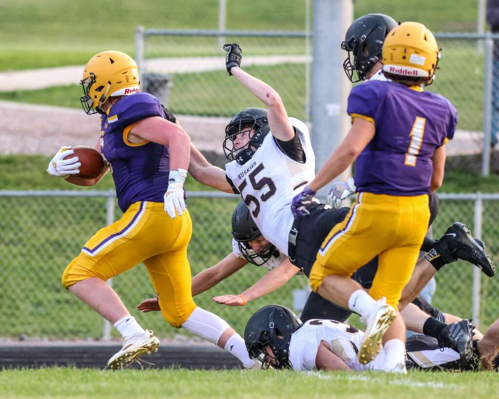 Battle Mountain's Marshal Jones, center, reaches out in a tackle attempt on Basalt's Cooper Crawford during their game on Thursday, Sept. 2, 2021, on the BHS field. | Photo by Austin Colbert/The Aspen Times