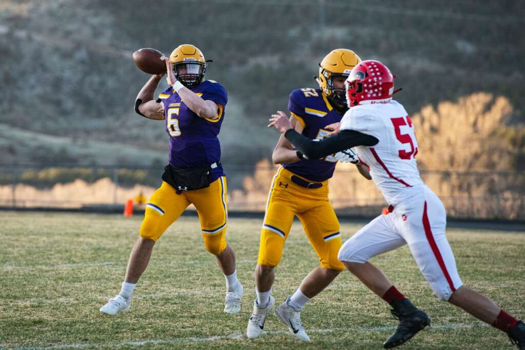 Basalt High School's senior Matty Gillis looks to pass the ball during a game against Glenwood Springs on Friday, April 9, 2021. (Kelsey Brunner/The Aspen Times)
