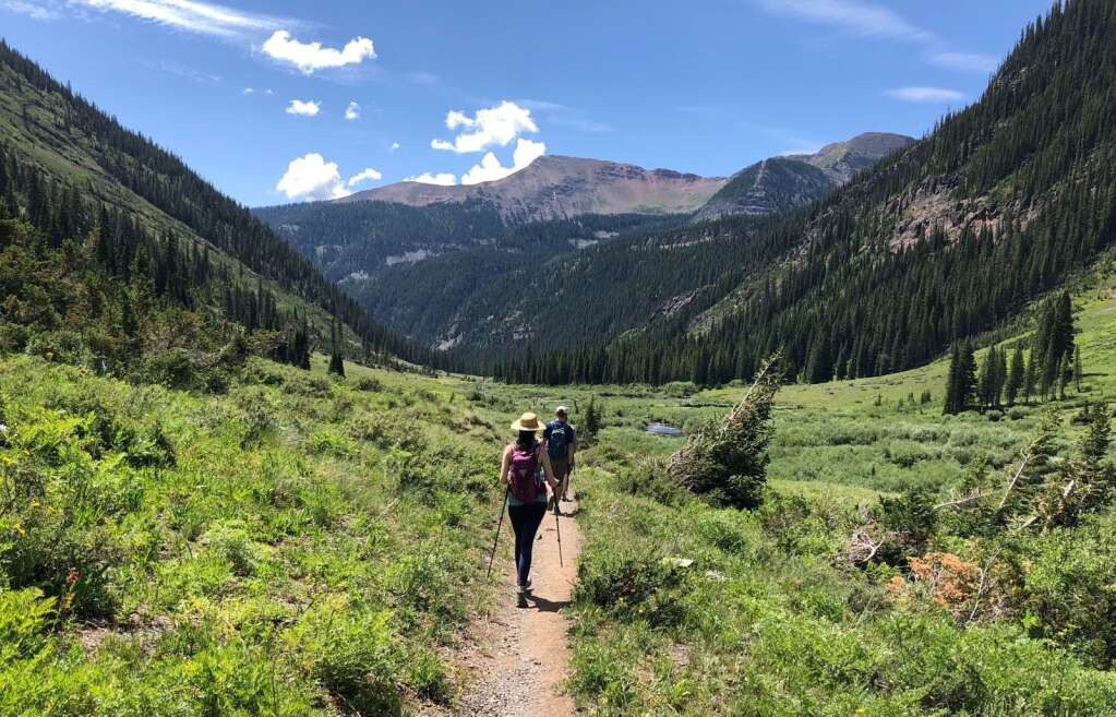 Hikers head up a trail in the Gunnison National Forest last summer. Visitation is surging in national forests while staffing in the Forest Service falls at the local level.   Scott Condon/The Aspen Times
