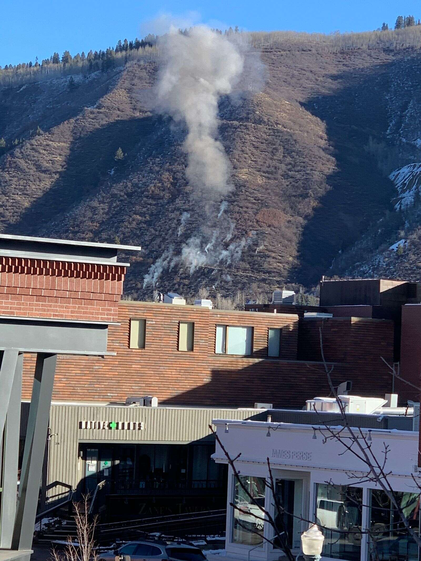 Smoke is seen rising from the area of Smuggler Mine on Saturday morning. Photo courtesy of Peter Grenney.