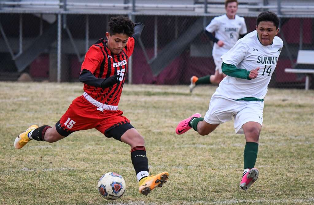 Glenwood Springs Demon Christopher Contreras dribbles the ball down the field during Tuesday night's game against the Summit Tigers. |Chelsea Self / Post Independent