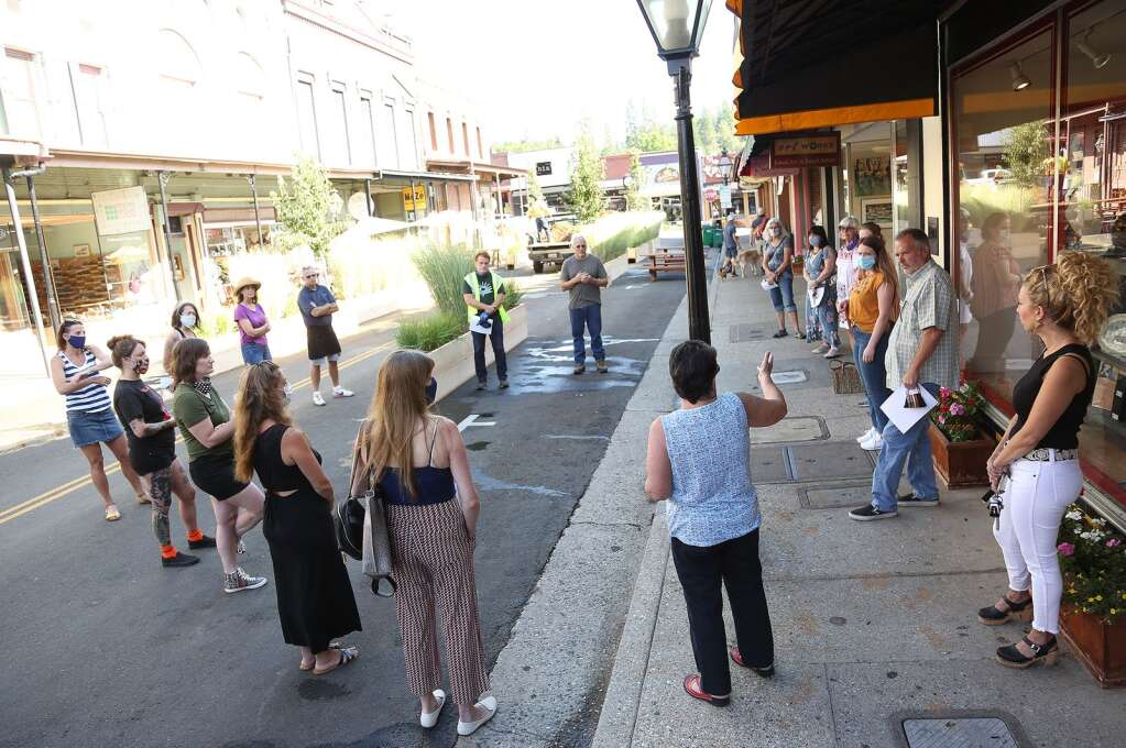 A group of concerned downtown Grass Valley business owners meets with Grass Valley City Manager Tim Kiser and Community Development Director Tom Last the morning of July 18 to discuss the changes being made to Mill Street. | Photo: Elias Funez