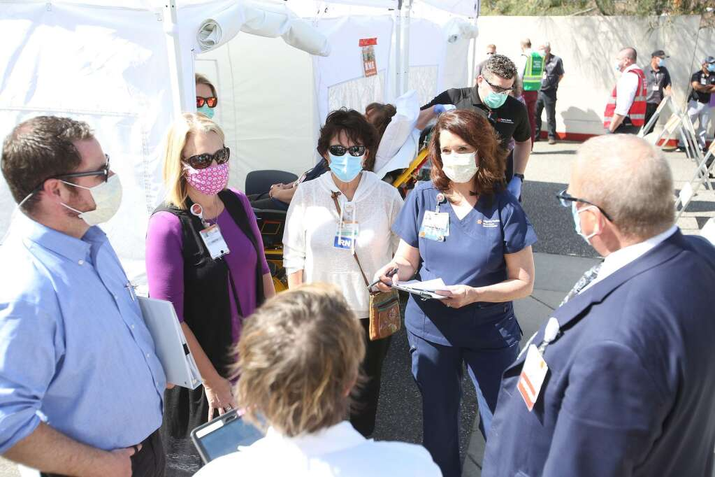 About 75 to 100 members of the hospital, Nevada County, local EMS, and Hospice of the Foothills took part in a high surge COVID drill to test their ability to handle the potential of a surge in coronavirus cases. | Photo: Elias Funez