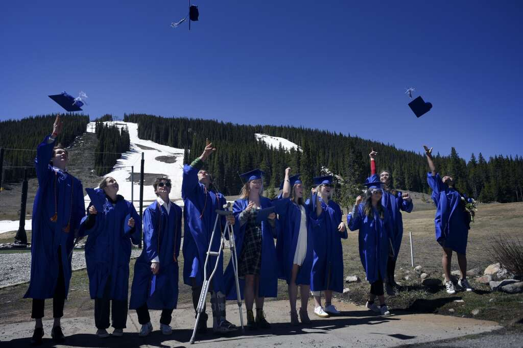 Graduates of The Peak School celebrate by tossing their caps into the air after their graduation at Copper Mountain Resort on Thursday, May 27.   Photo by Jason Connolly /Jason Connolly Photography
