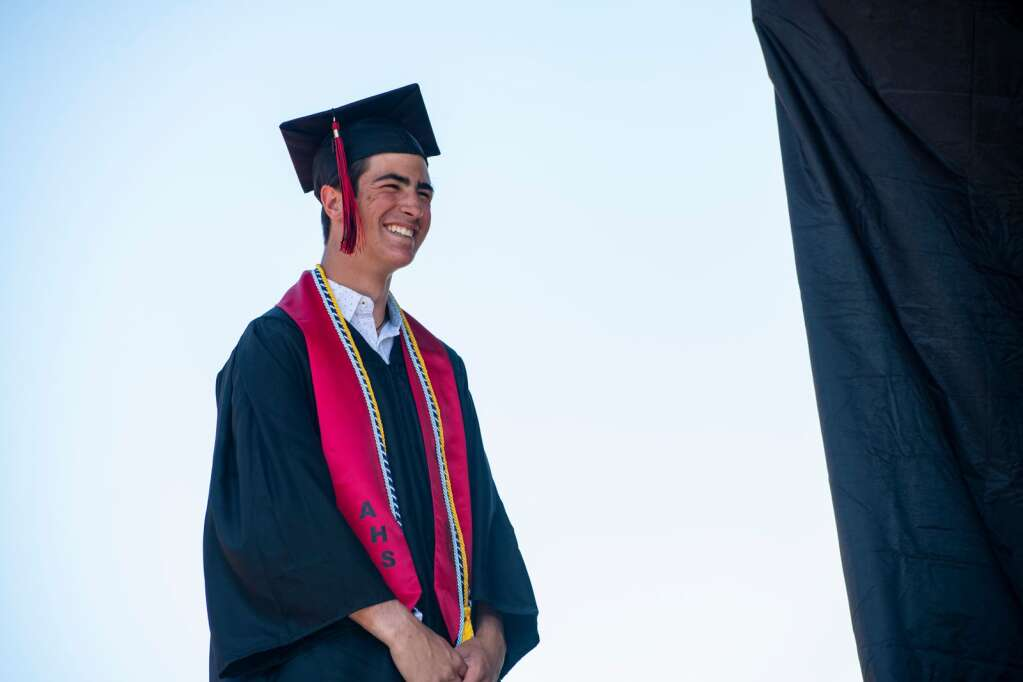 An Aspen High School graduate crosses the stage during the commencement ceremony on the football field on Saturday, June 5, 2021. (Kelsey Brunner/The Aspen Times)