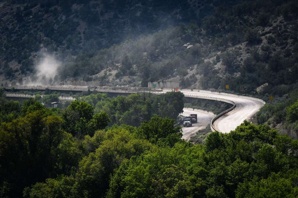 Dusts fills the air as CDOT trucks travel the east and westbound decks of Interstate 70 through Glenwood Canyon near Bair Ranch MM 129.  |Chelsea Self / Post Independent