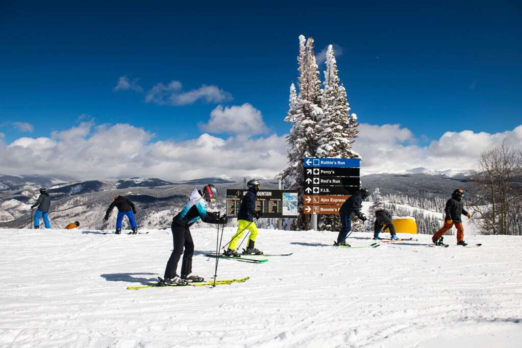 Skiers unload from the Ruthie's Lift and traverse on the catwalk on Aspen Mountain on Thursday, Feb. 18, 2021. (Kelsey Brunner/The Aspen Times)