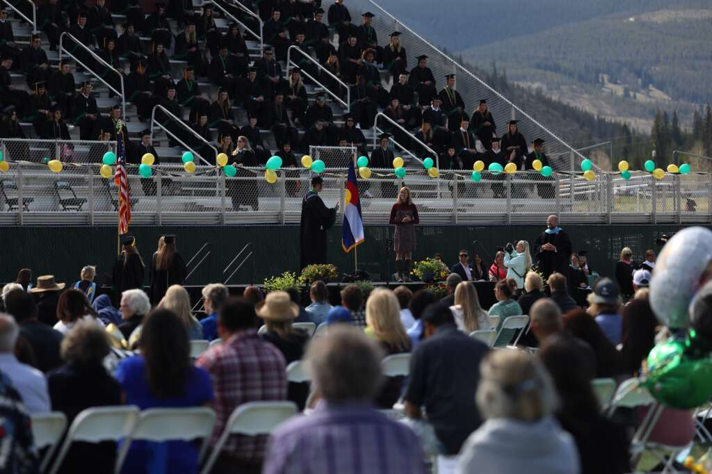 Students from the Summit High School class of 2021 walk across the stage during a graduation ceremony for the class of 2021 on Saturday, May 29, in Breckenridge.