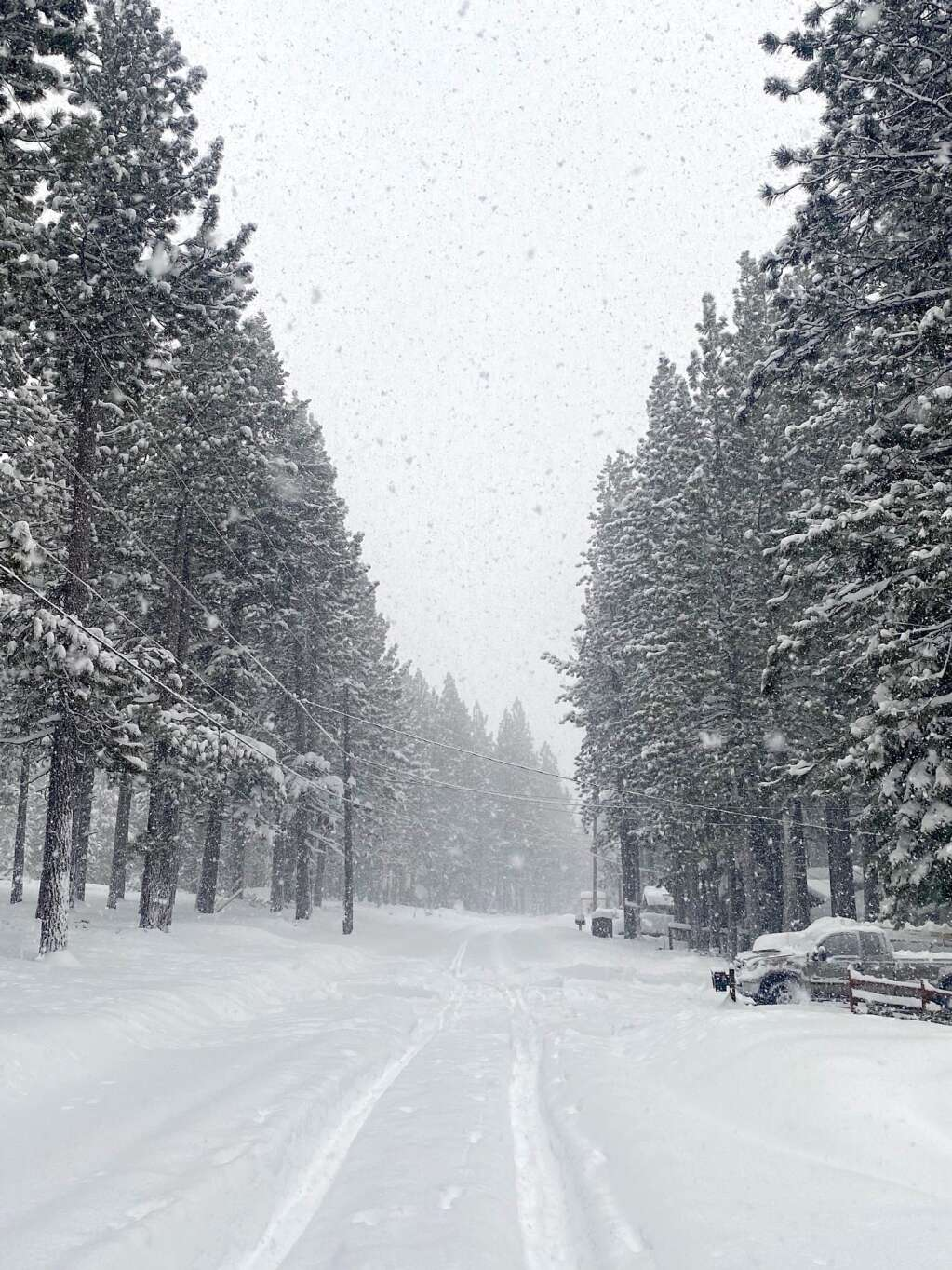 County roads in South Lake Tahoe were buried in about 2 feet of snow Thursday morning. <em id=